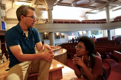 English instructor Alex Myers chats to a student after Assembly.