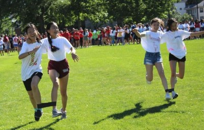 Students compete in Field Day's three-legged race