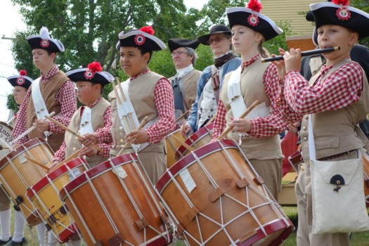 Drums of freedom: young reenactors salute the late arrival of the Declaration of Independence.